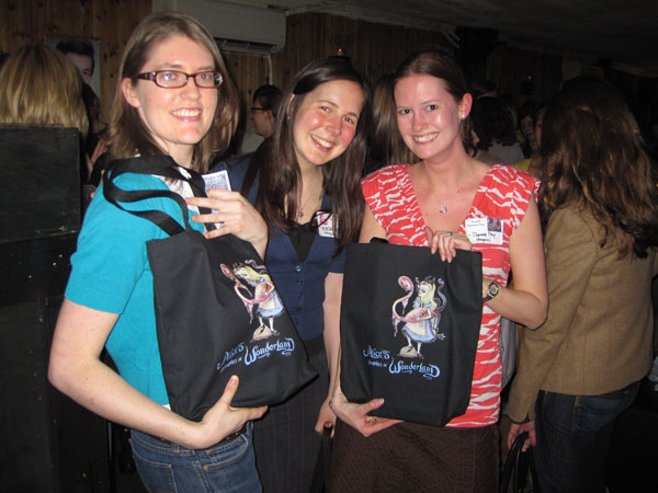 Tote bag winners show off their prizes